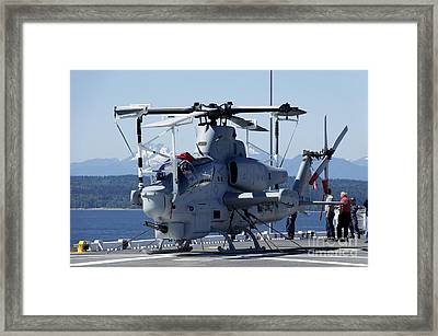 An Ah-1w Cobra Is Chained To The Flight Framed Print by Stocktrek Images