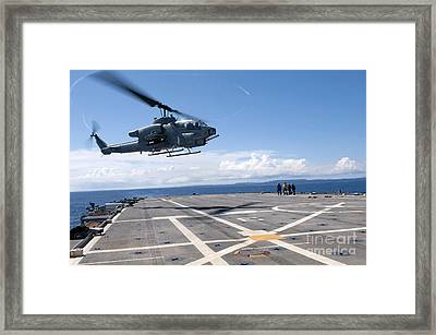 An Ah-1w Super Cobra Helicopter Lands Framed Print by Stocktrek Images
