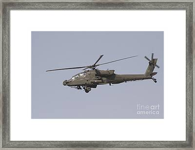 An Ah-64 Apache In Flight Framed Print by Terry Moore