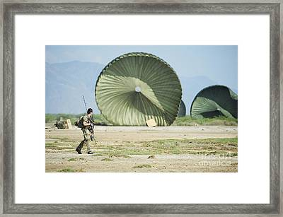 An Air Delivery Of Humanitarian Aid Framed Print by Stocktrek Images