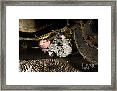An Airman Inspects The Undercarriage Framed Print by Stocktrek Images