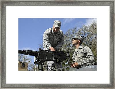 An Airman Instructs A Cadet On How Framed Print by Stocktrek Images