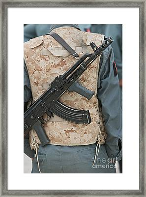 An Ak-47 Rests On The Sling Of An Framed Print