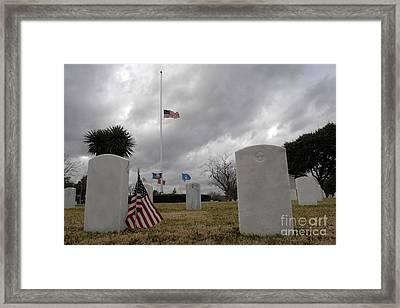 An American Flag Flies At Half Staff Framed Print