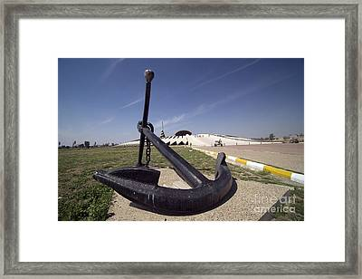An Anchor Sits At The Entrance Framed Print