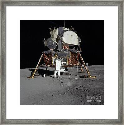 An Apollo 11 Astronaut In Front Framed Print by Stocktrek Images