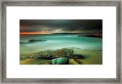 An Aqua Dawn Framed Print