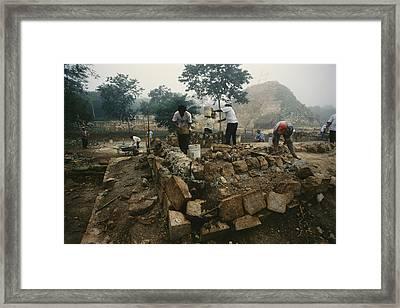 An Archaeological Team Works Framed Print