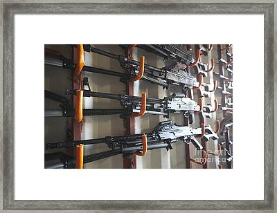 An Armory Of Pk Machine Guns Designed Framed Print by Terry Moore