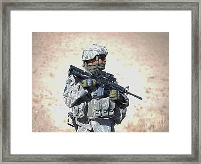 An Army Soldier Stands Guard While Framed Print