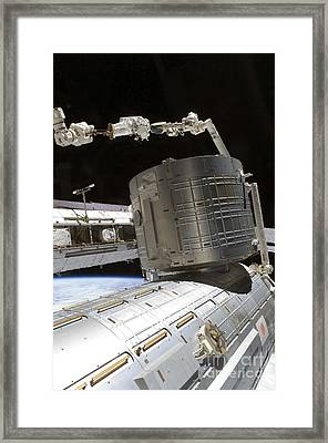 An Astronaut Anchored To A Mobile Foot Framed Print