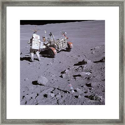 An Astronaut And A Lunar Roving Vehicle Framed Print by Stocktrek Images