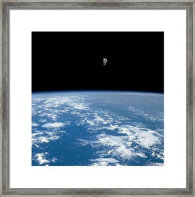 An Astronaut Propelled Above The Earth Framed Print by Nasa
