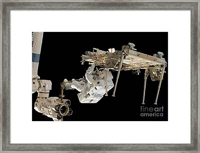An Astronaut With His Feet Secured Framed Print by Stocktrek Images