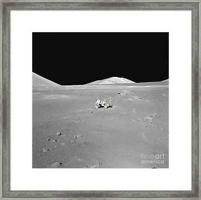 An Astronaut Working At The Lunar Framed Print by Stocktrek Images