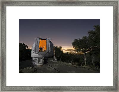 An Astronomer Works Inside A Dome Framed Print