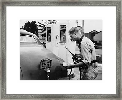 An Automobile Service Station Attendant Framed Print by Everett