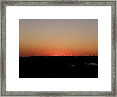 An Autumn Sunset Framed Print by Kim Galluzzo Wozniak