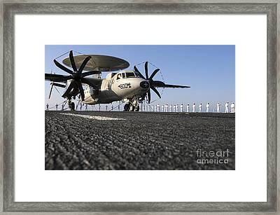 An E-2c Hawkeye Sits On The Flight Deck Framed Print by Stocktrek Images