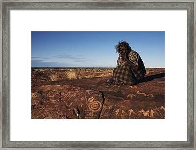 An Eastern Arrernte Woman Ponders Framed Print