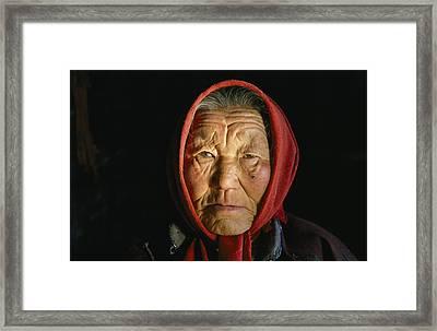 An Elderly Kazakh Woman In Western Framed Print by David Edwards