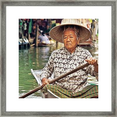 An Elderly Lady Rowing Along The Framed Print
