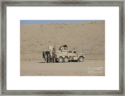 An Eod Cougar Mrap In A Wadi Framed Print by Terry Moore