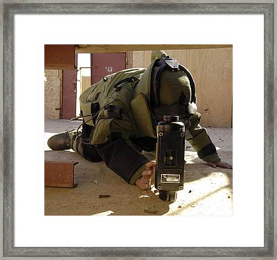 An Eod Member Places An X-ray Machine Framed Print