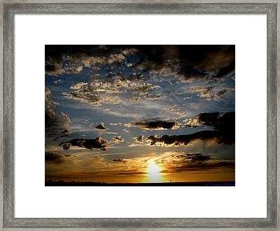 An Evening Walk Under The Sunset Framed Print by Aaron Burrows