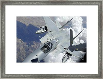 An F-15 Eagle Pulls Away From A Kc-135 Framed Print by Stocktrek Images