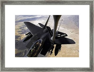 An F-15e Strike Eagle Aircraft Receives Framed Print by Stocktrek Images