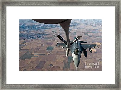 An F-16 Fighting Falcon Moves Framed Print by Stocktrek Images