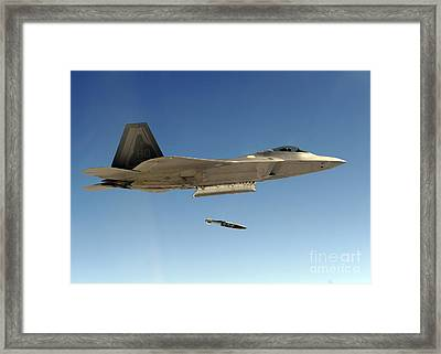 An F-22a Raptor Drops A Gbu-32 Bomb Framed Print by Stocktrek Images