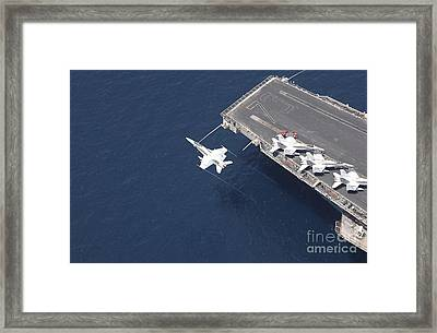 An Fa-18 Hornet Flys Over Aircraft Framed Print by Stocktrek Images