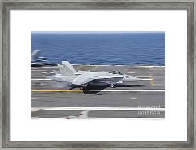 An Fa-18c Hornet Lands Aboard Uss Framed Print by Stocktrek Images