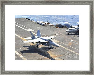 An Fa-18e Super Hornet Lands Aboard Framed Print by Stocktrek Images