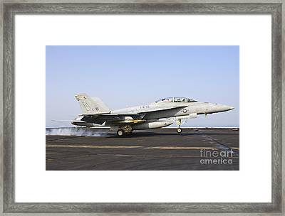 An Fa-18e Super Hornet Lands Aboard Uss Framed Print by Giovanni Colla