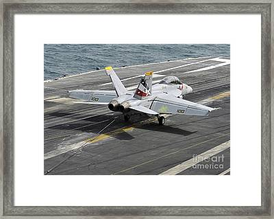 An Fa-18f Super Hornet Traps An Framed Print by Stocktrek Images