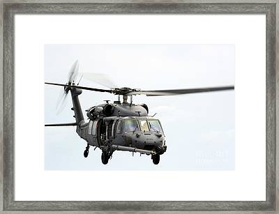 An Hh-60 Pave Hawk Helicopter Conducts Framed Print by Stocktrek Images