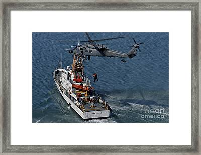 An Hh-60g Pave Hawk Performs A Hoist Framed Print by Stocktrek Images