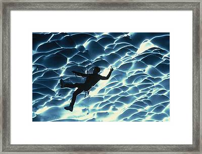 An Ice Climber Crosses The Ceiling Framed Print by Carsten Peter