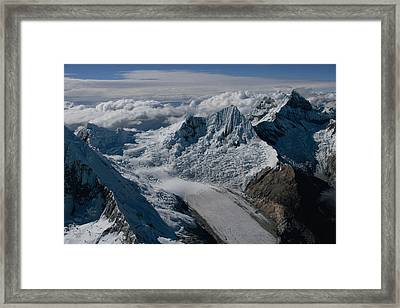 An Icy Ravine Between Glacial Peaks Framed Print by Bobby Haas