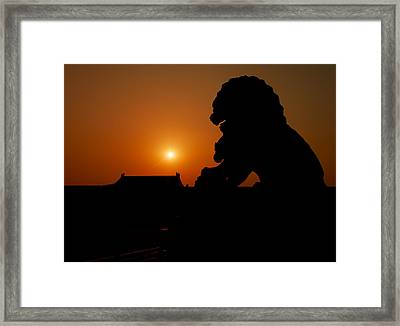 An Imperial Guardian Lion Statue Sits Framed Print by Justin Guariglia