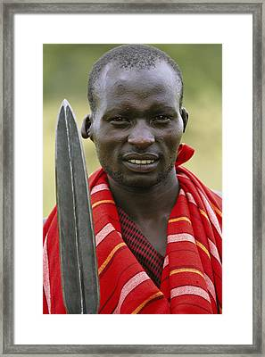 An Informal Portrait Of A Masai Warrior Framed Print by Michael Melford
