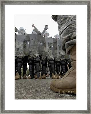 An Instructor Stands Face-to-face Framed Print by Stocktrek Images