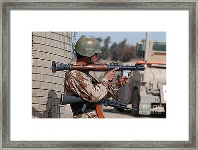 An Iraqi Army Soldier Aims His Rocket Framed Print by Stocktrek Images