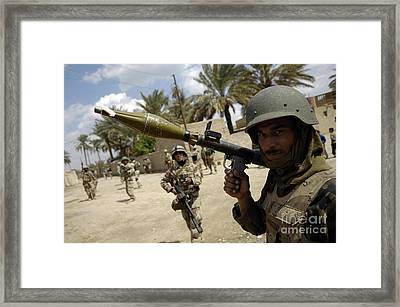 An Iraqi Army Soldier Provides Security Framed Print