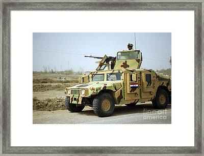 An Iraqi Soldier Provides Security Framed Print by Stocktrek Images