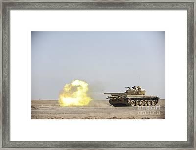 An Iraqi T-72 Tank Fires At The Besmaya Framed Print by Stocktrek Images