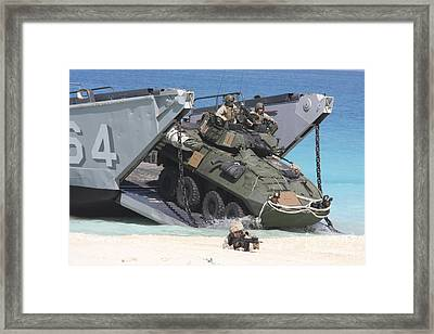 An Lav-25 Exits A Landing Craft Utility Framed Print by Stocktrek Images